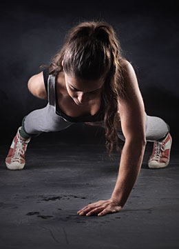 woman one arm push up