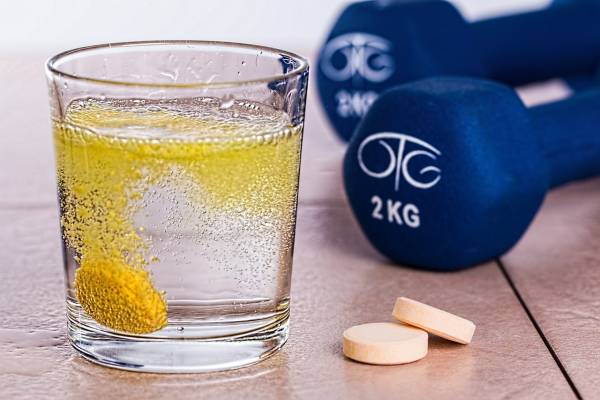 supplement and dumbbell